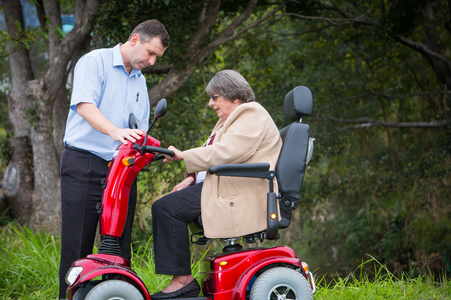 An image of a Scooters Australia Brisbane customer, Patricia, driving her Monarch Wrangler.