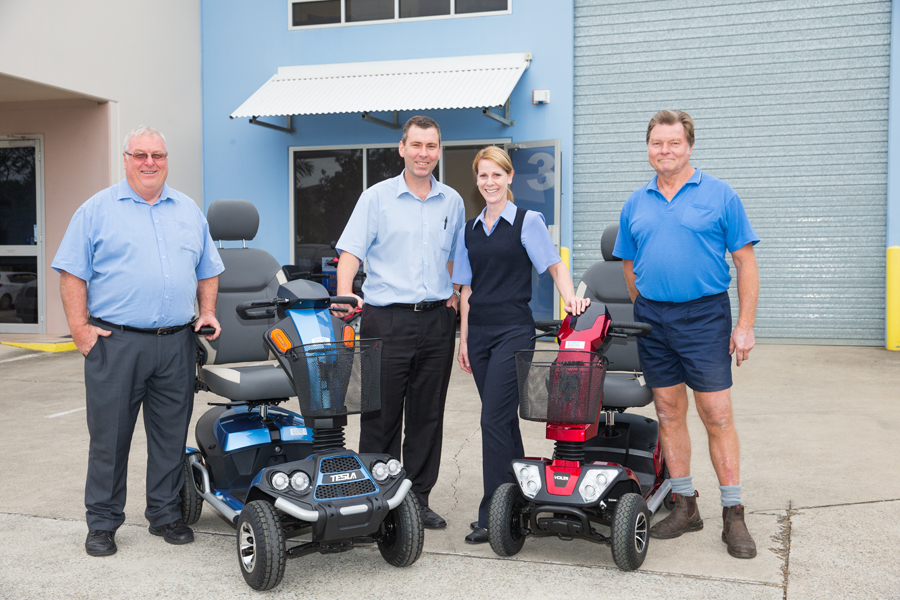 Image of Scooters Australia Brisbane Team with two Mobility Scooters
