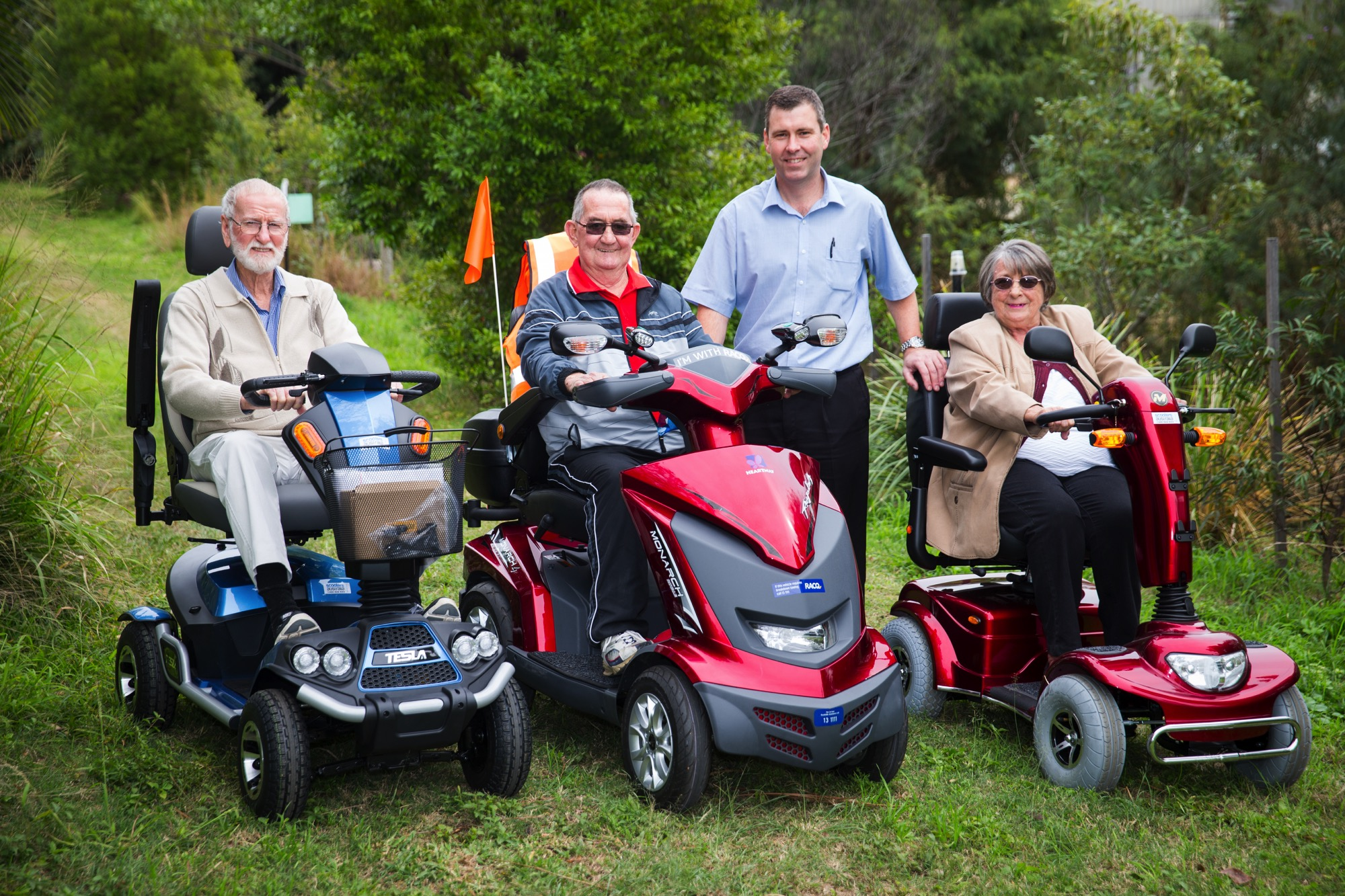 An Image Of John, From Scooters Australia Brisbane, And Three Customers On Their Electric Mobility Scooters.