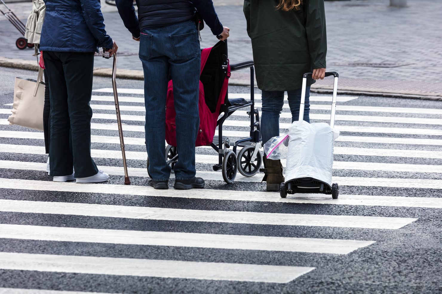 Pedestrians using pedestrian crossing